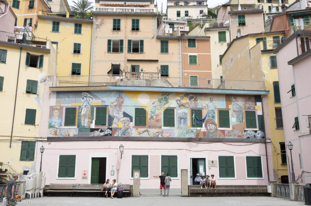 Instead of going down the stairs towards the harbor, head up to see this mural in Riomaggiore.