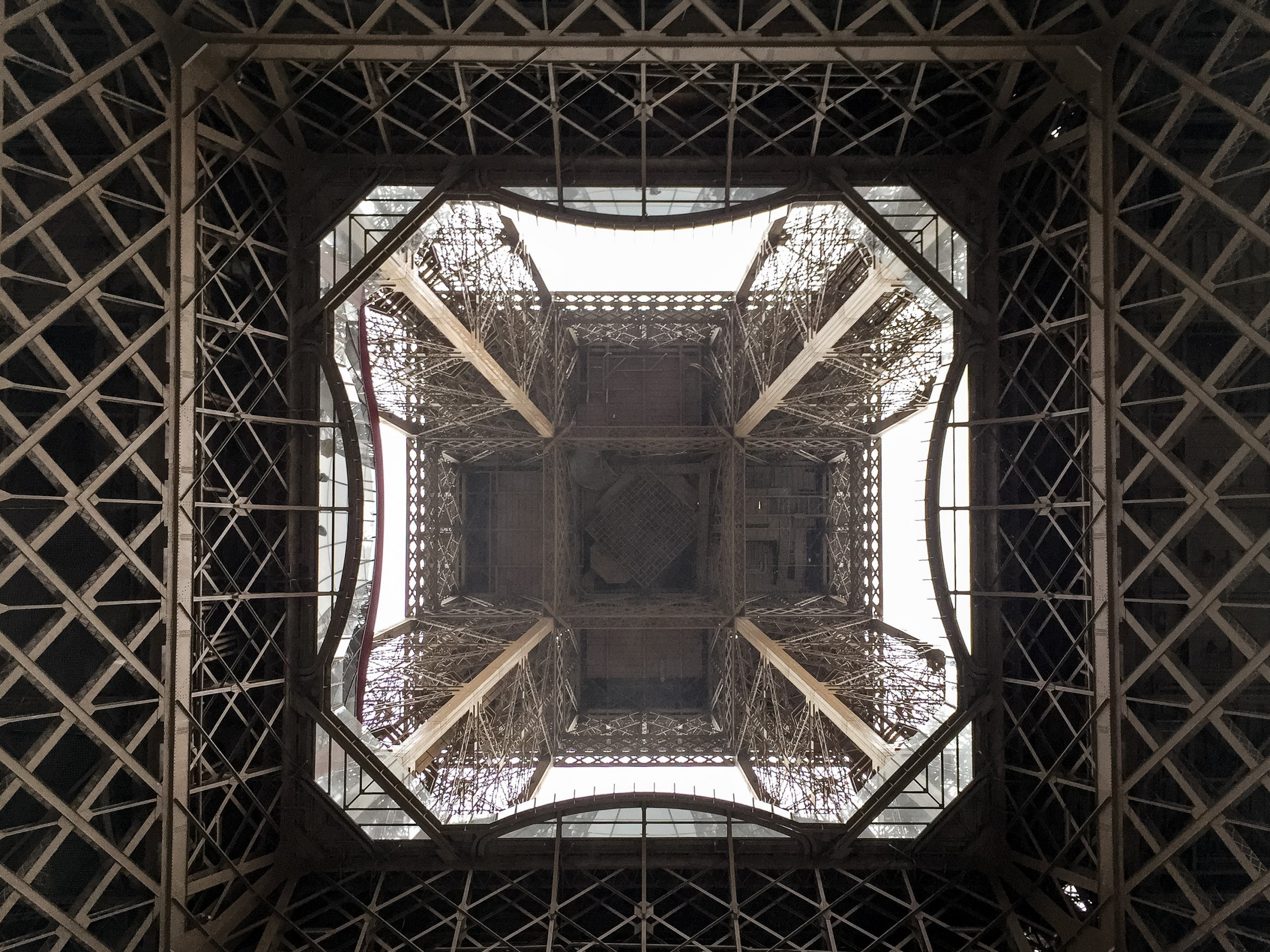 View of the underneath of the Eiffel Tower in Paris, France