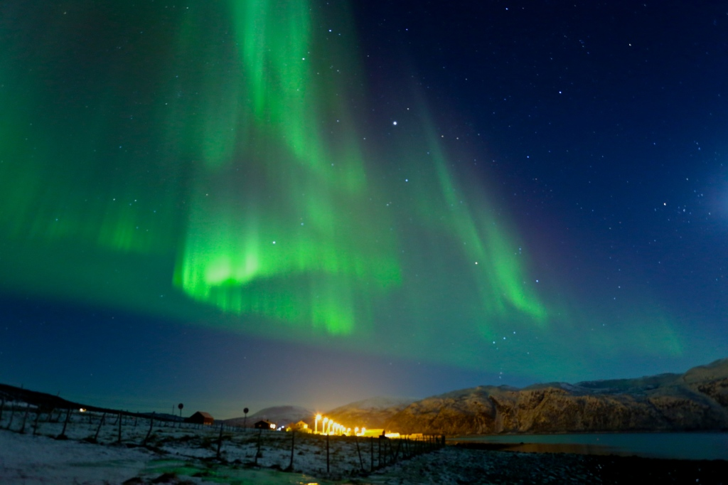 Watching the northern lights dance above us in the sky in Tromsø, Norway