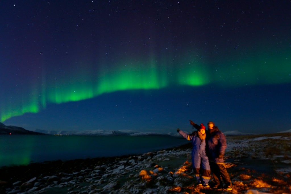 Standing under the beauty of the northern lights near Tromsø, Norway