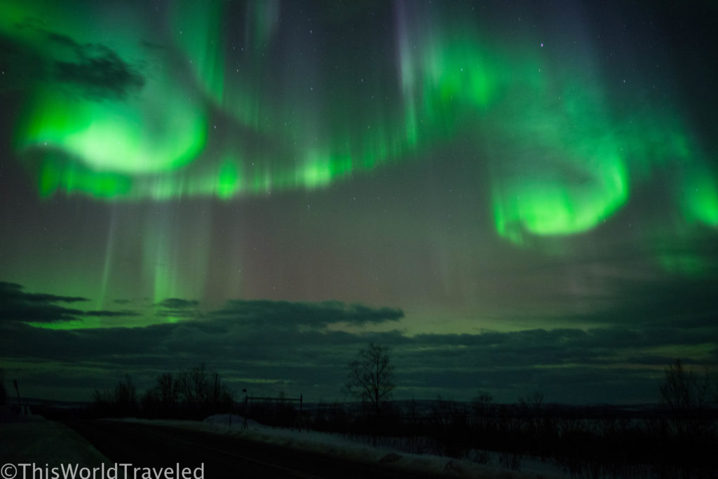 The green colors of the aurora borealis swirling around in the sky near Tromsø, Norway