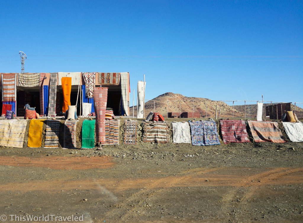 Rugs for sale along the road during our drive from Marrakech through the Atlas Mountains