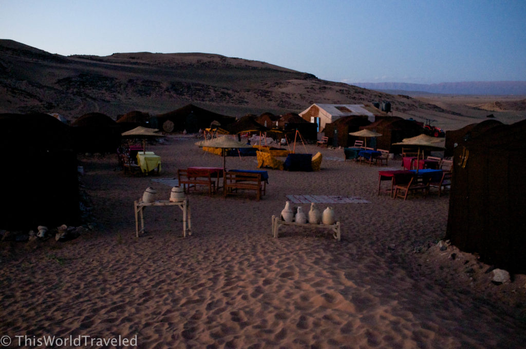 The desert camp as the sun sets in Morocco