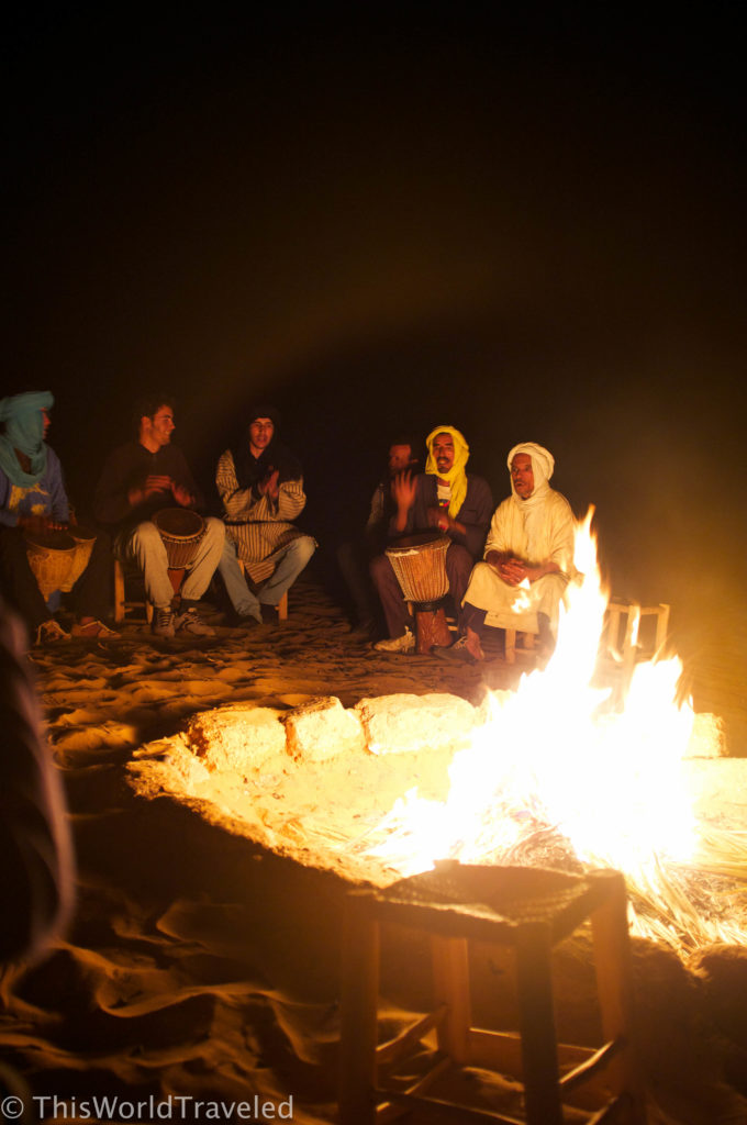 Singing songs and playing instruments around the campfire in the Zagora desert in Morocco