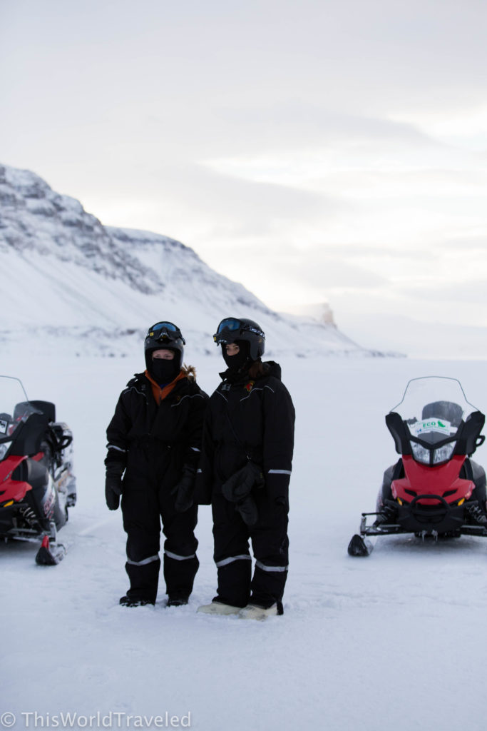 Covered head to toe in our warm snowsuits for our snowmobiling in Svalbard