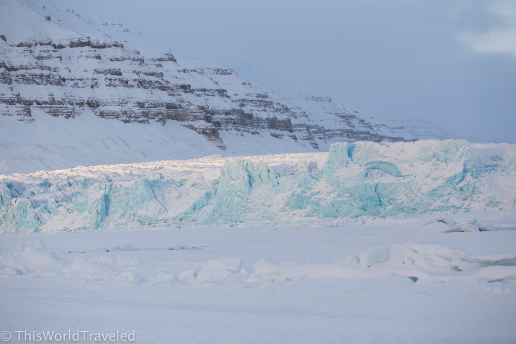 Blue ice colored glacier in Svalbard, Norway