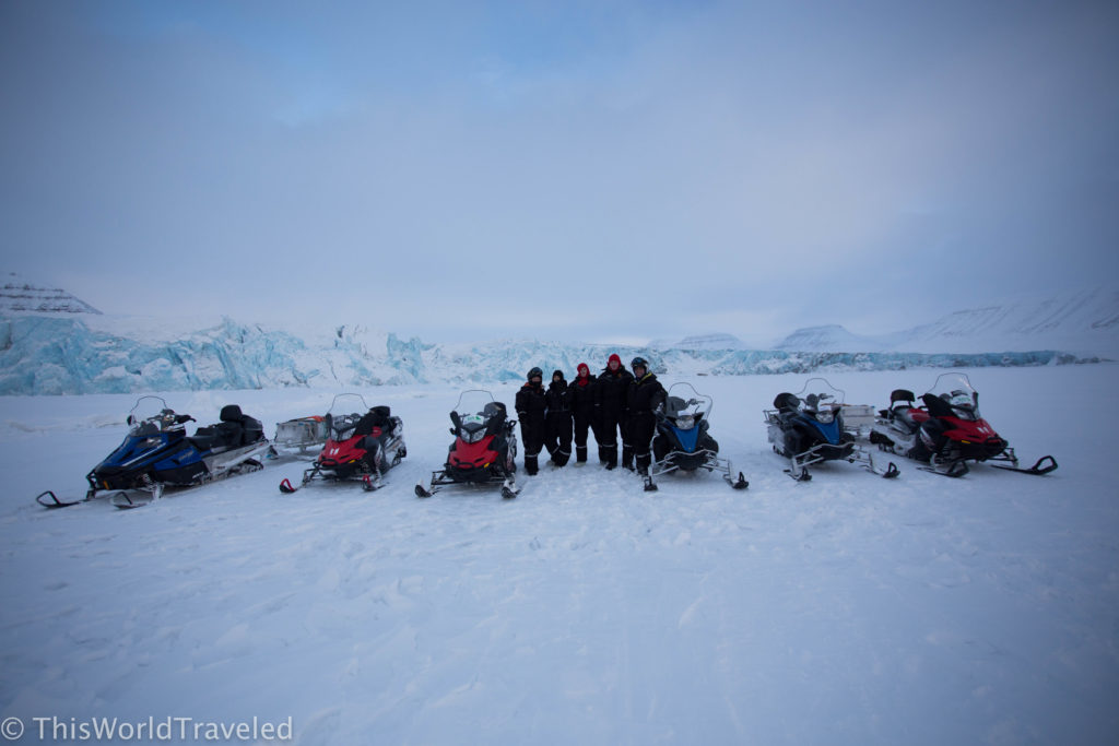 Our group posing with the stunning glacier backdrop in Svalbard