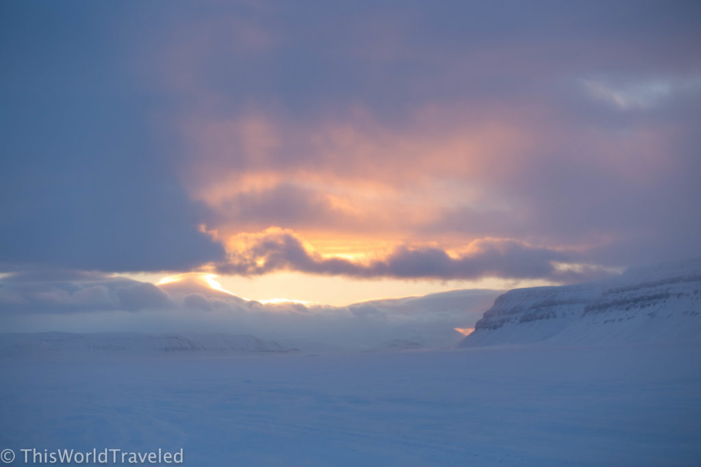 The sun setting over the snow in Svalbard