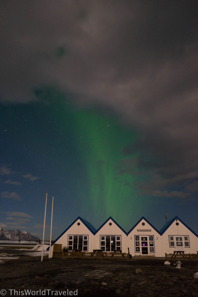 Photographing the Northern lights above Iceland's wooden houses