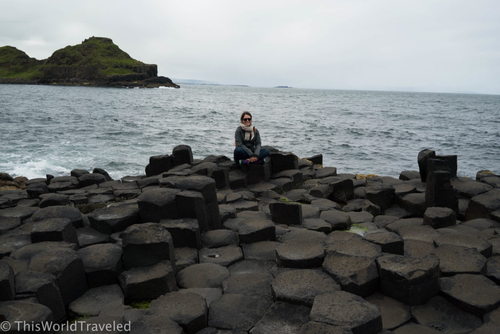 Sitting on the stacked basalt columns at Giant's Causeway in Northern Ireland