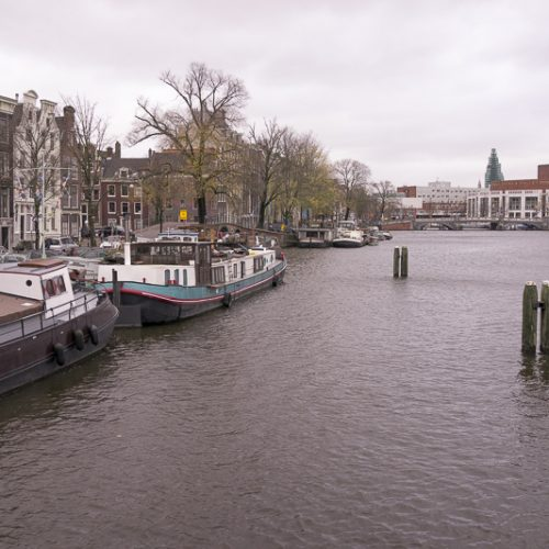 Staying on a house boat in Amsterdam is a fun way to immerse yourself in the city.