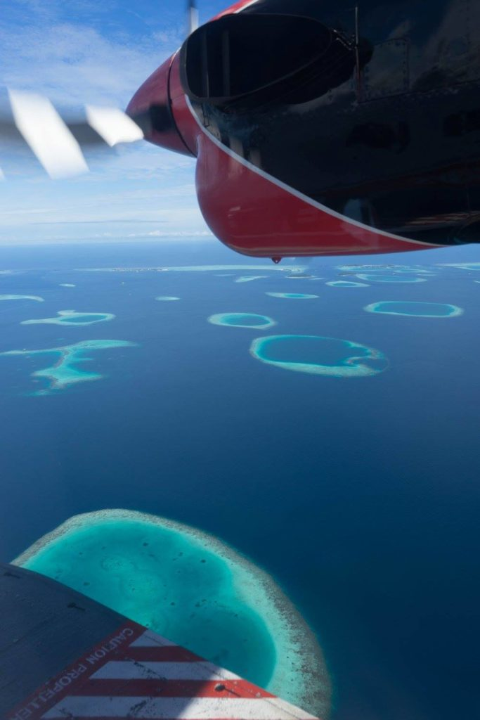 Flying over the different atolls in the Maldives on a sea plane