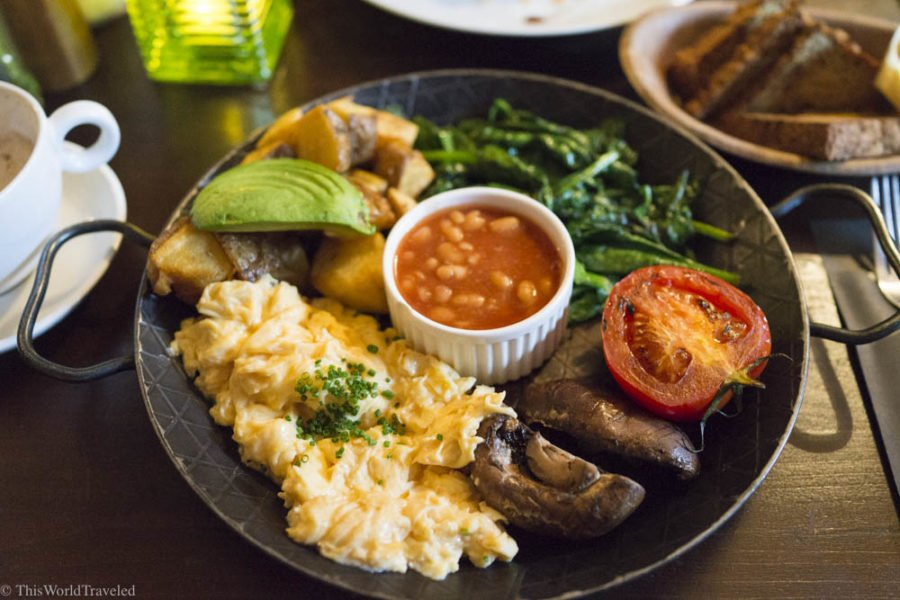 A delicious breakfast of eggs, mushrooms, spinach, avocado and more at Greenwoods in Amsterdam