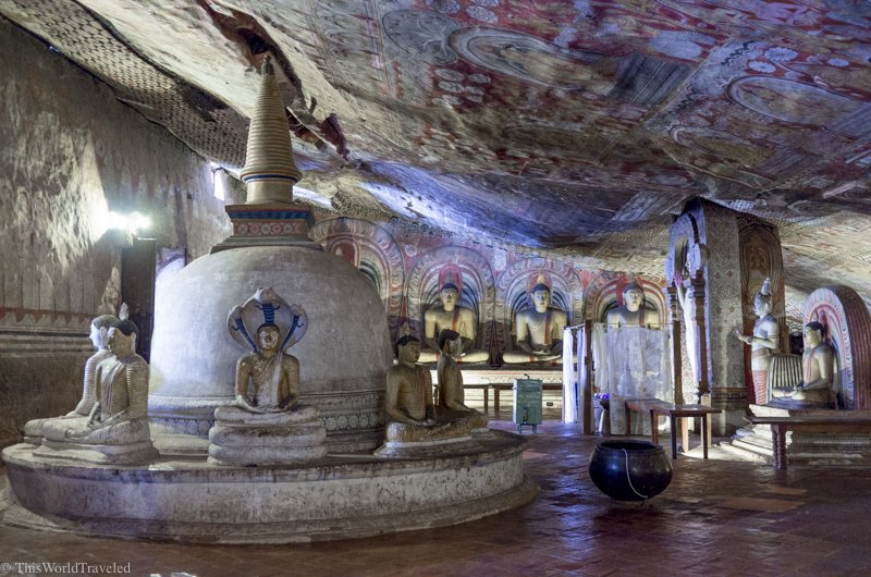 Inside the Dambulla Cave Temples in Sri Lanka are many buddha statues and elaborate frescos painted on the walls.