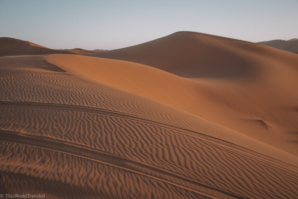The sand dunes of the Erg Chebbi desert in Morocco look stunning in the sunset.