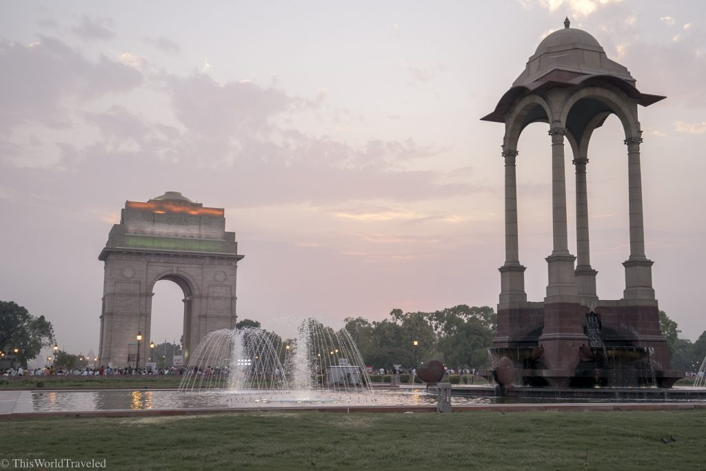 Large gate in Delhi, India lit up with the green, orange and white which are the colors of the Indian flag.