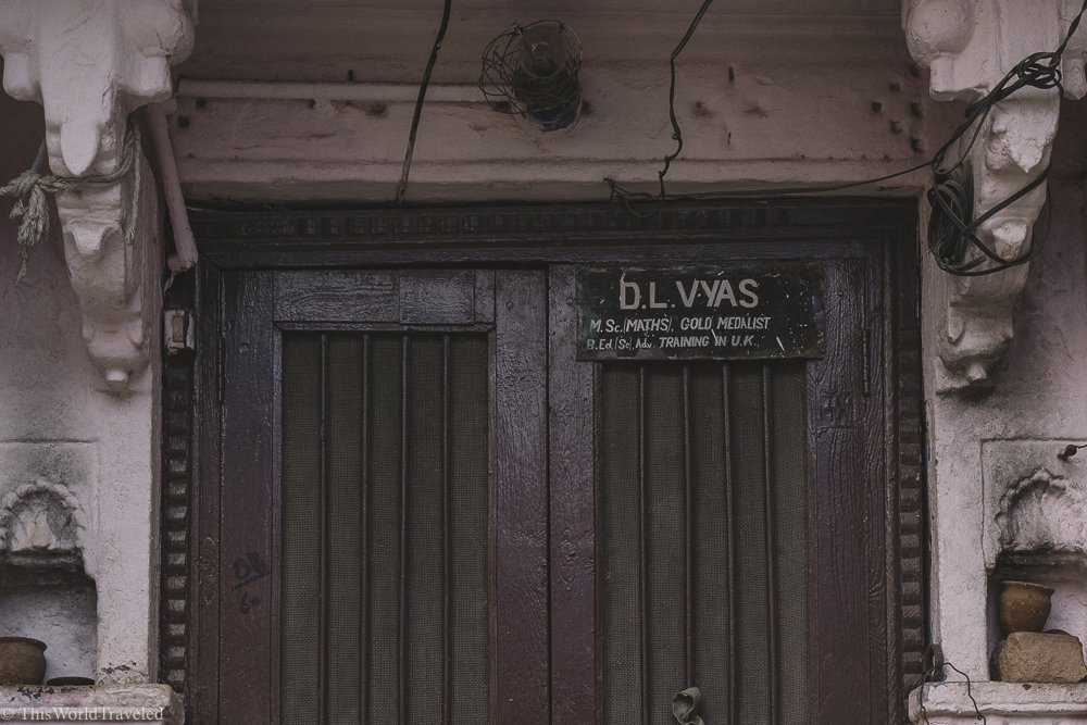 In india, there are name plates above the doors of many of the homes