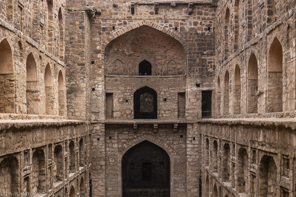 Large, 3 level step well in Delhi, India. There are many archways and this used to hold water but is now dry.