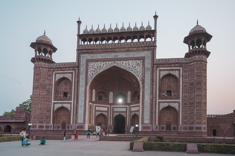 The red and white building of the east gate entrance to the Taj Mahal in Agra, India