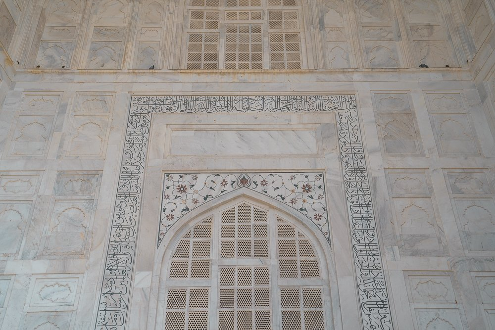 The up close details of the flower design made from semiprecious stones laid in the marble on the Taj Mahal