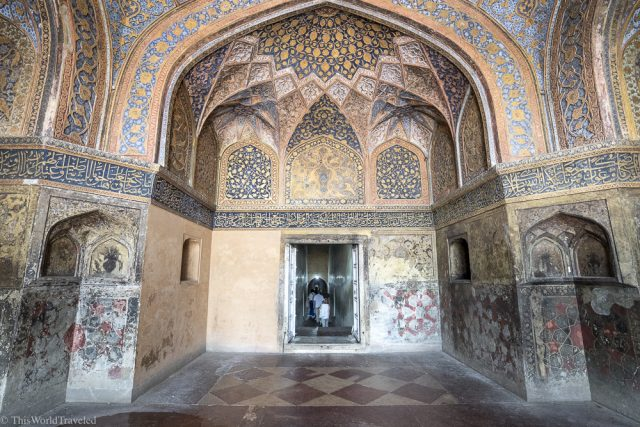 inside the tomb of Akbar in Agra, India the walls are painted many colors with beautiful designs