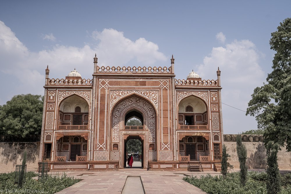 Red and white building in Agra, India. The red is made from sandstone and the building has very intricate details