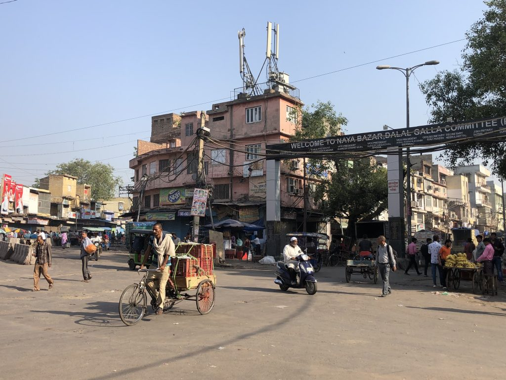 busy street in india with lots of motorbikes and people