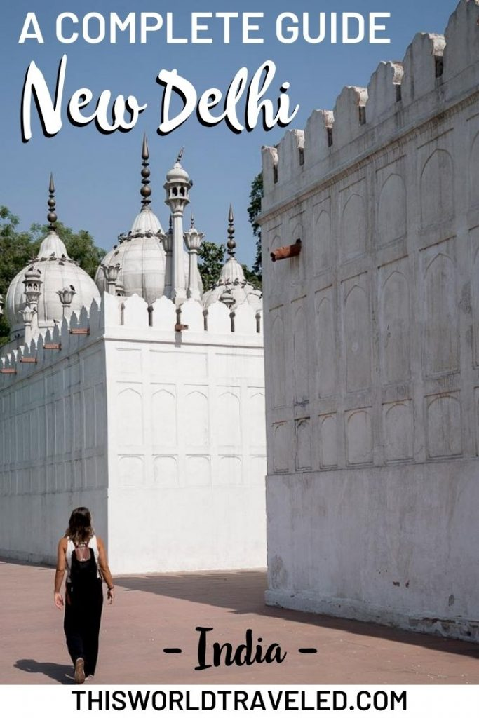 Girl walking through an ornate, white structure in New Delhi, India