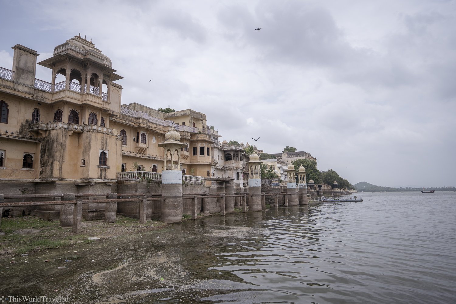 View of the buildings on Lake Pichola from a boat ride