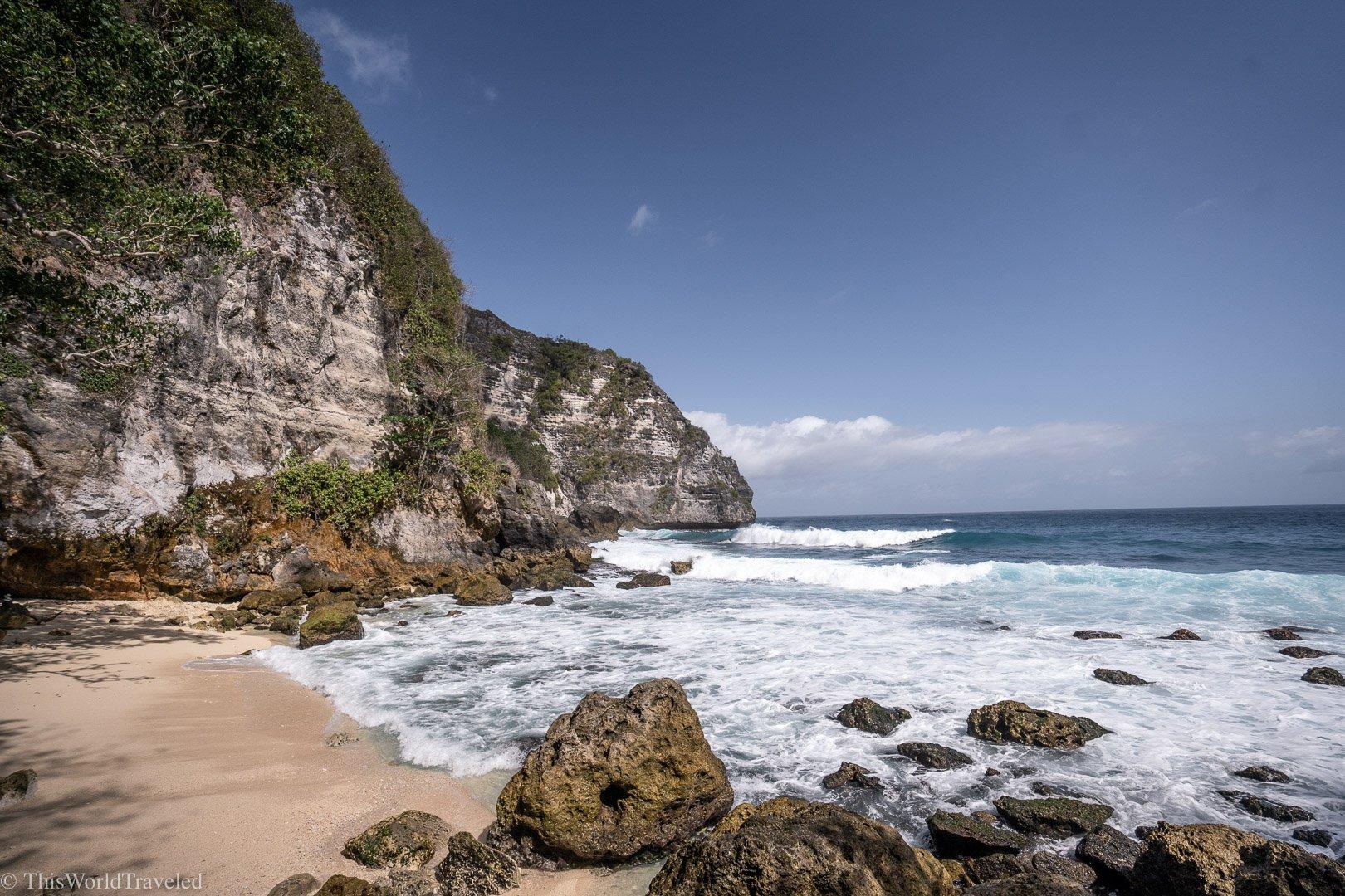 Sandy beach with limestone cliffs on Nusa Penida, Bali