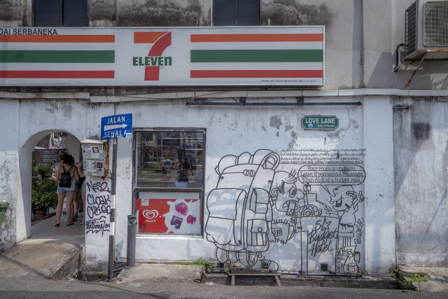 A 7 eleven with wire art work outside on a street in Georgetown, Penang in Malaysia