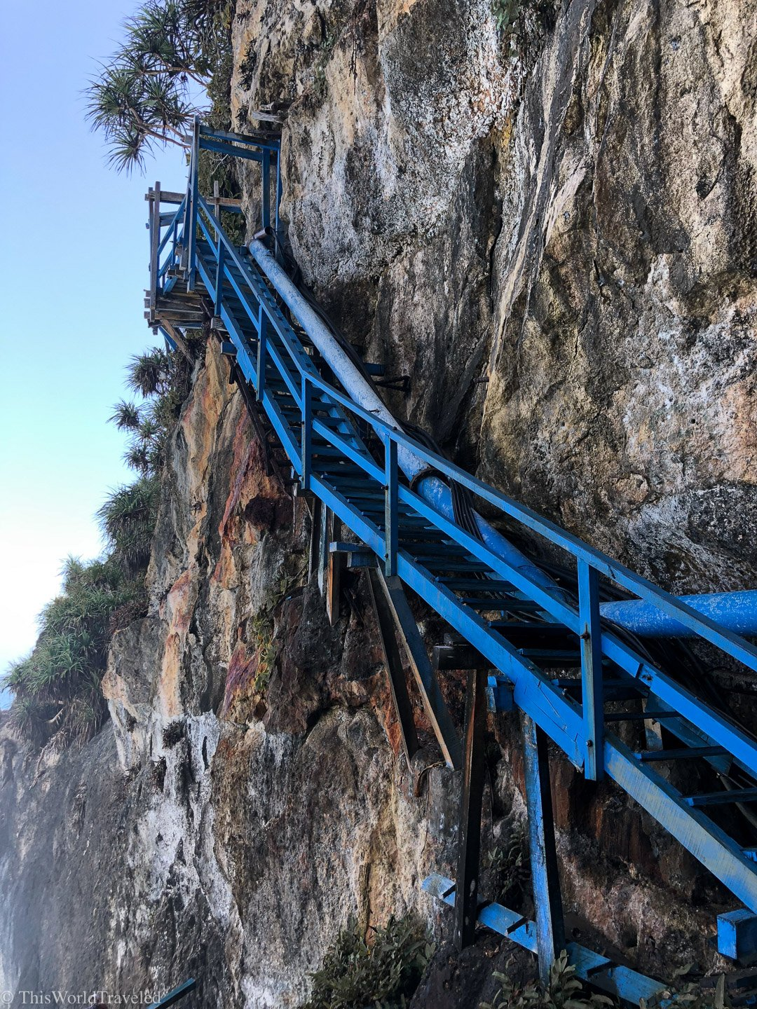 The steep blue stairs at the waterfall in Nusa Penida