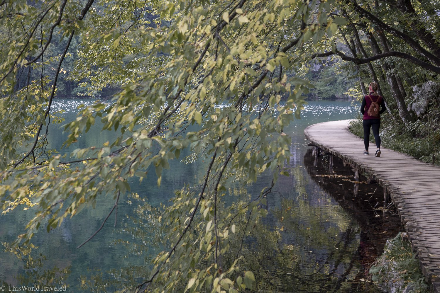 Girl walking on a boardwalk at Plitvice Lakes National Park in Croatia
