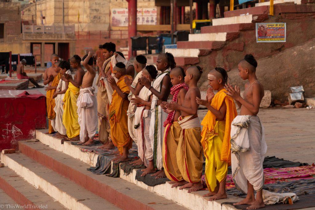Small boys in Varanasi doing morning yoga on the Ganges River