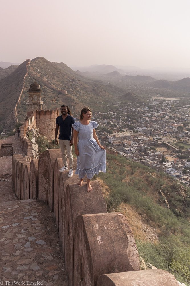Girl and guy walking along the Amber Fort Wall in Jaipur