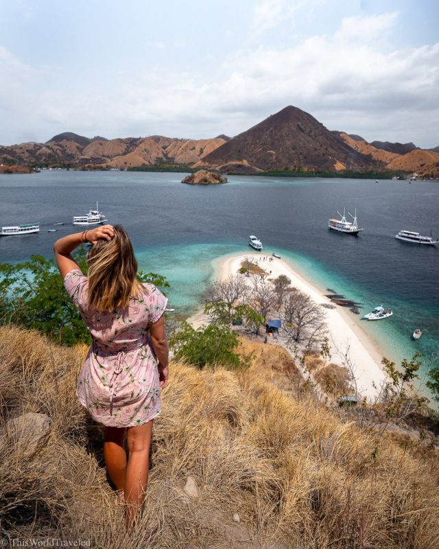 Girl standing at the top of Kelor Island in Indonesia