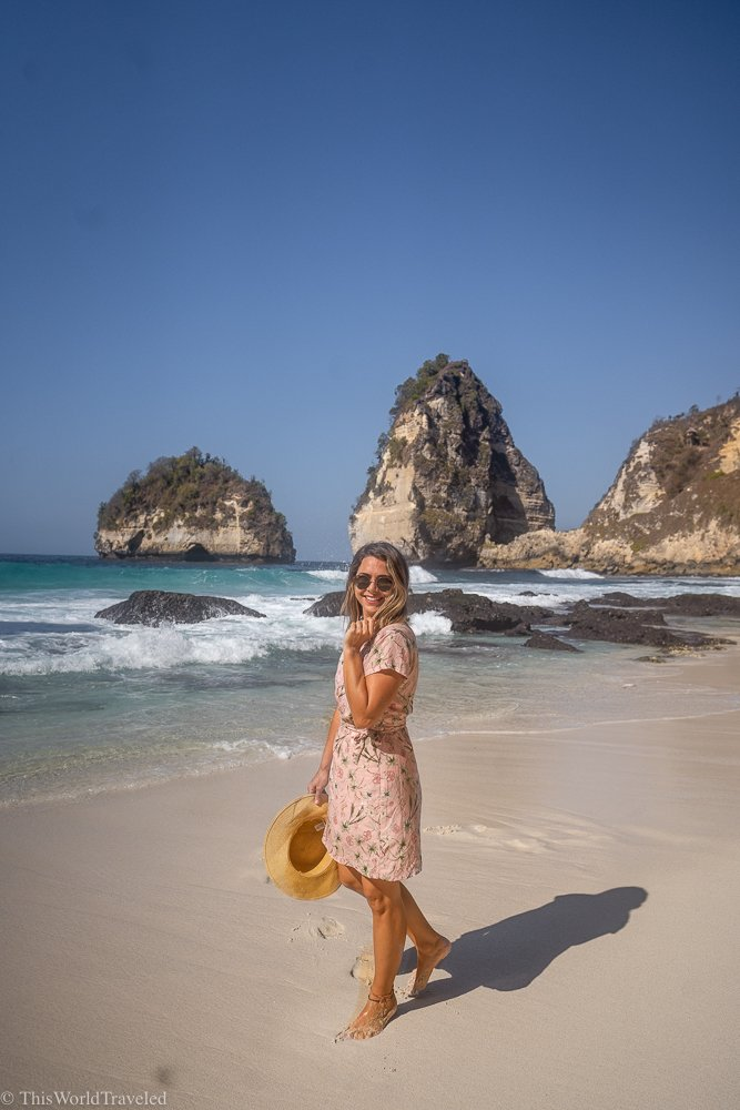 Girl standing on a white sandy beach on Nusa Penida's East Coast