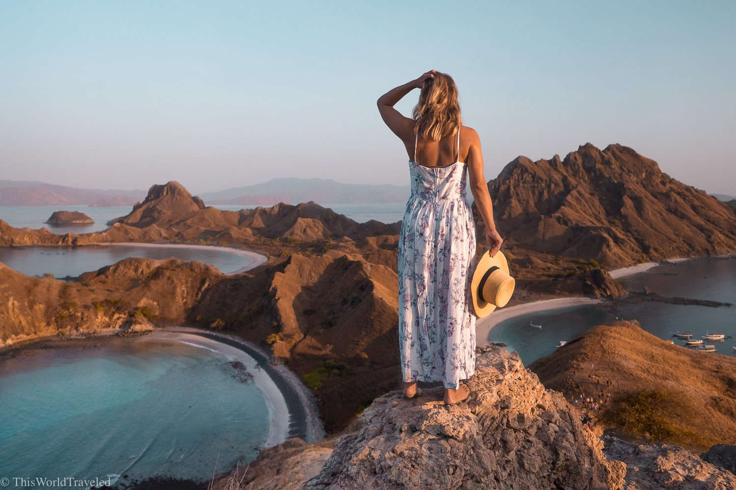 Girl standing on a rock on Padar Island in the Komodo Islands