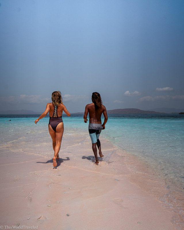 A couple running on a sandbank in the Komodo Islands