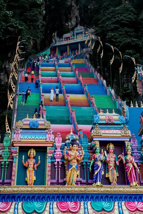 Climbing the 272 rainbow steps at the Batu Caves temple in Malaysia