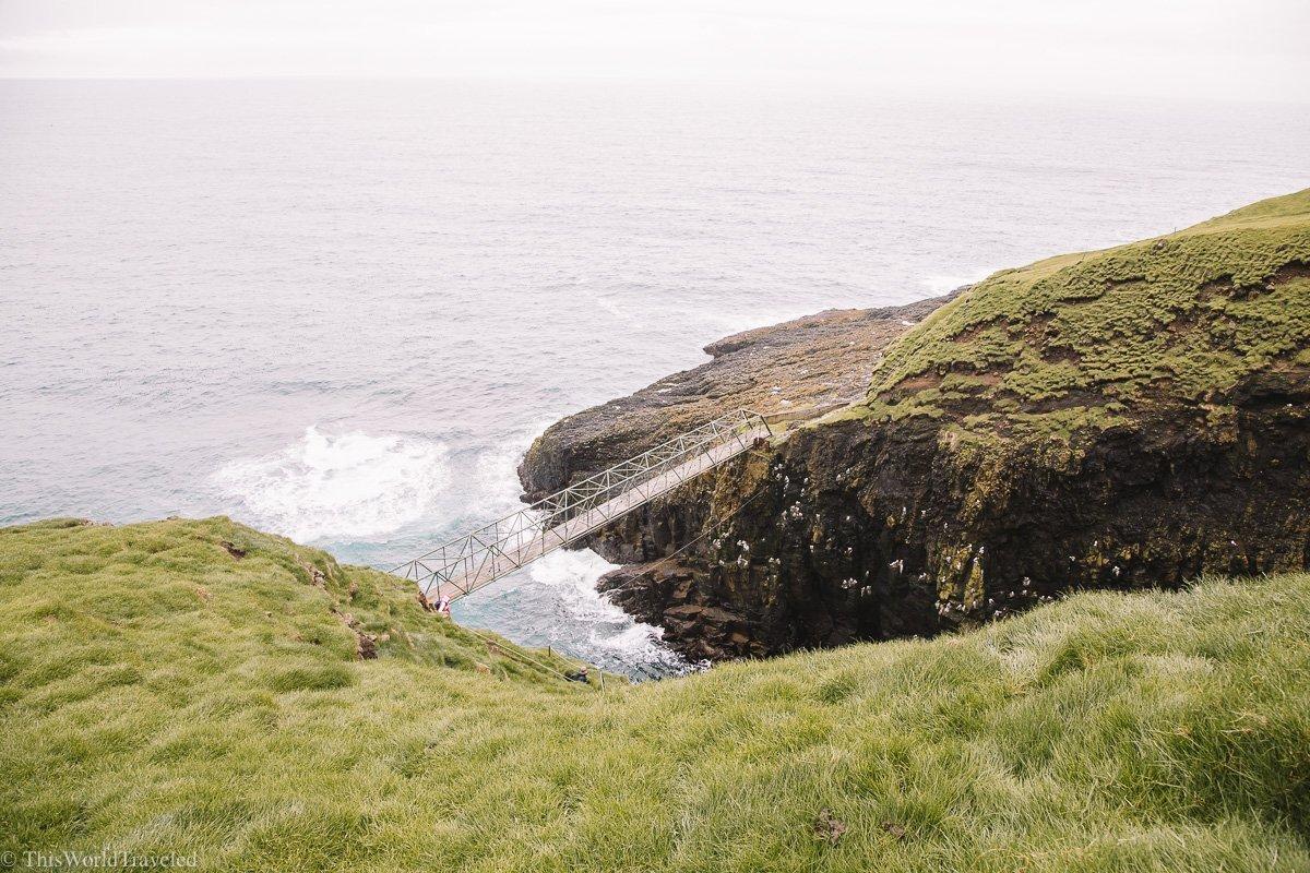 The bridge that crosses the Atlantic ocean in Mykines in the Faroe Islands