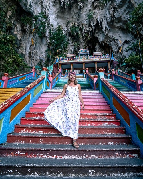 Girl on the steps of the Batu Caves in Malaysia