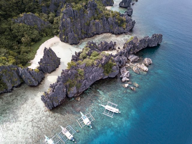 Drone shot of the hidden beach from a boat tour around Bacuit Bay in El Nido, Palawan