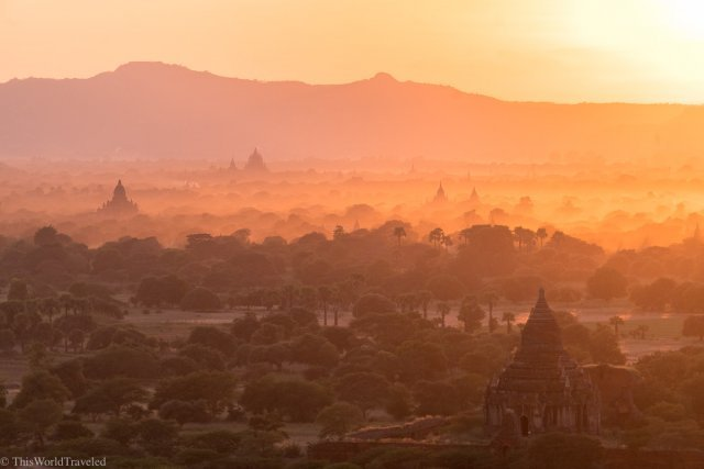 Sunset with colors of orange, yellow and red at the Bagan tower in Bagan, Myanmar