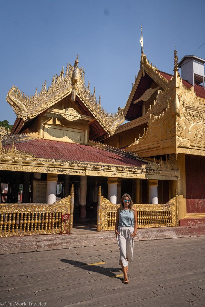 A girl walking in front of the buildings at the Mandalay Palace in Myanmar