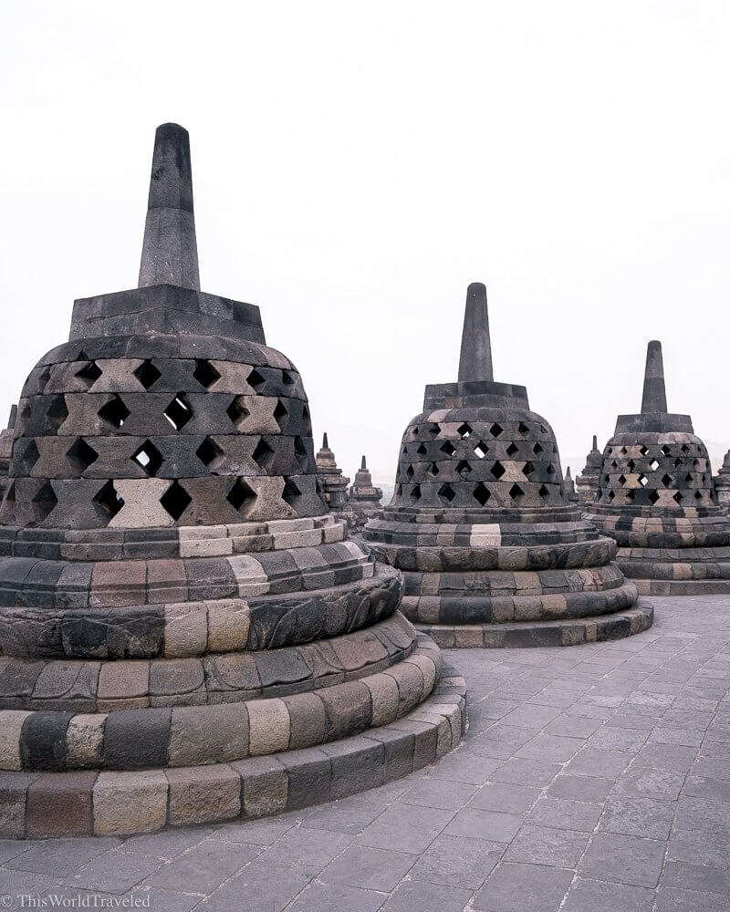 The stupas are located on the top level of the Borobudur Temple