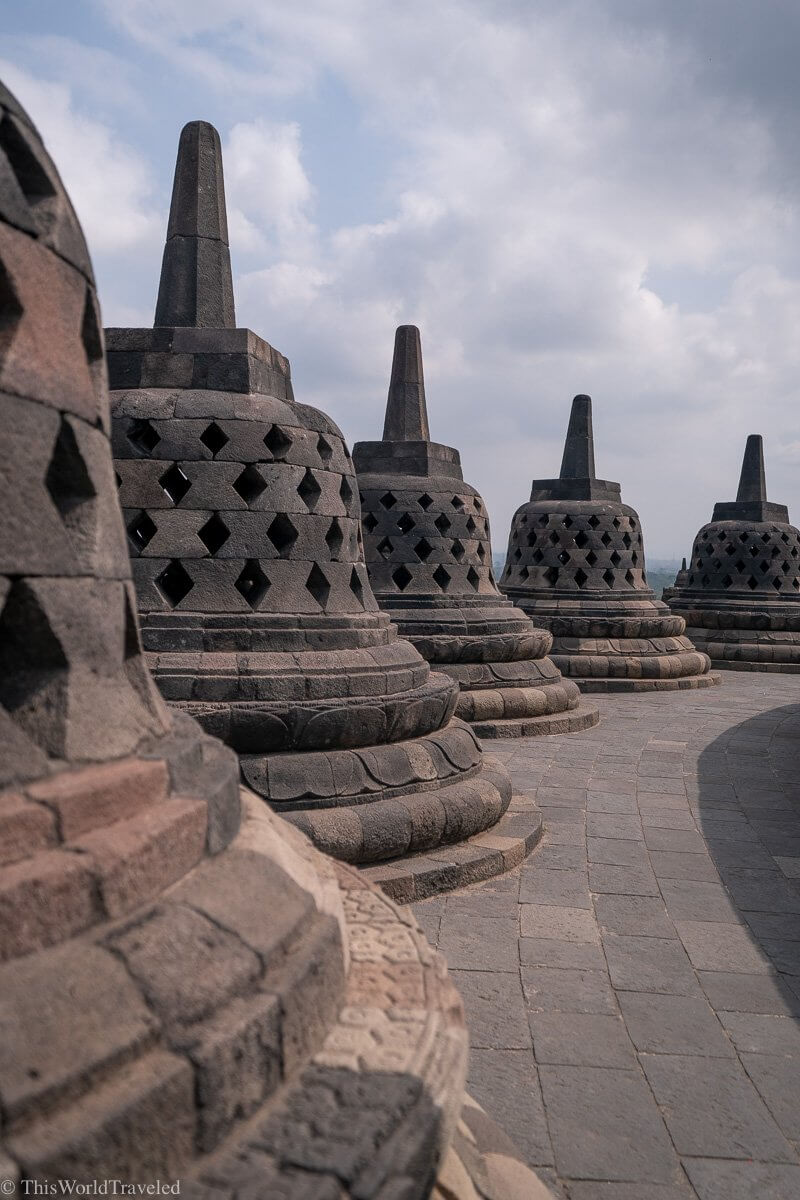 Some of the large stupas that are on the top level of the Borobudur Temple in Indonesia