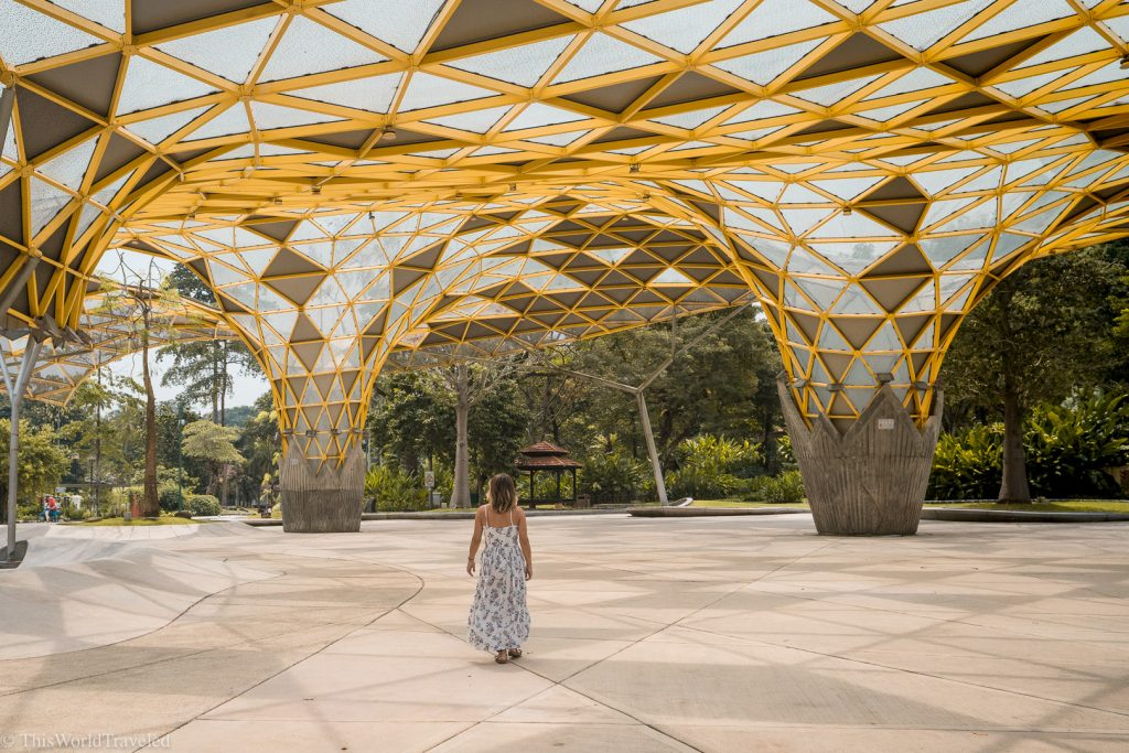 Girl walking through the Perdana Botanical Gardens in Kuala Lumpur, Malaysia