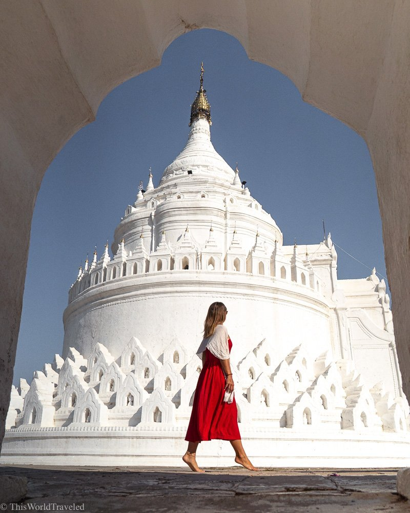 Girl in a red dress and white shawl at the Mya Thein Tan Pagoda in Mandalay