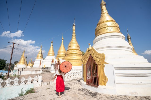 Girl with red dress and red umbrella at the Shwe Kyat Yat Pagoda in Mandalay